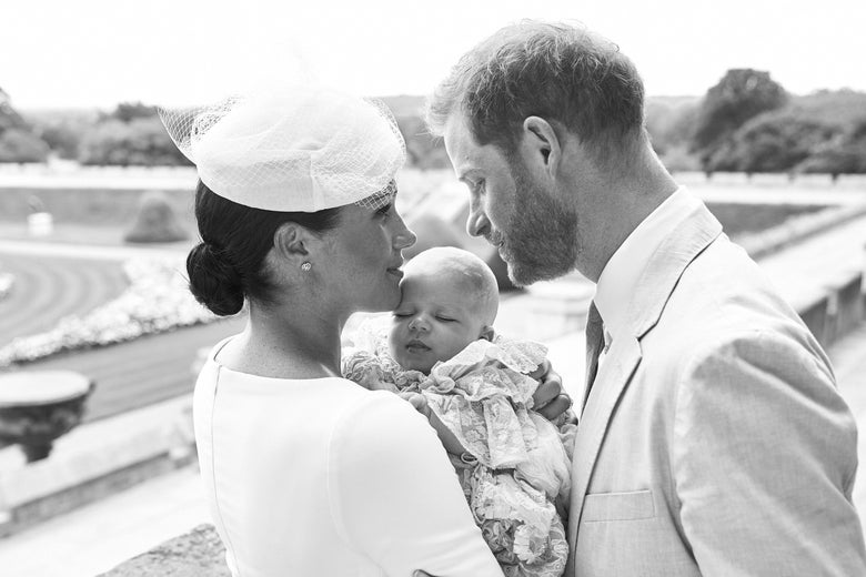 The Duke and Duchess of Sussex holding their newly-baptized child.