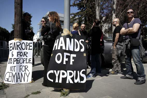 A group of demonstrators hold an anti-bailout rally outside the parliament in Nicosia March 18, 2013.