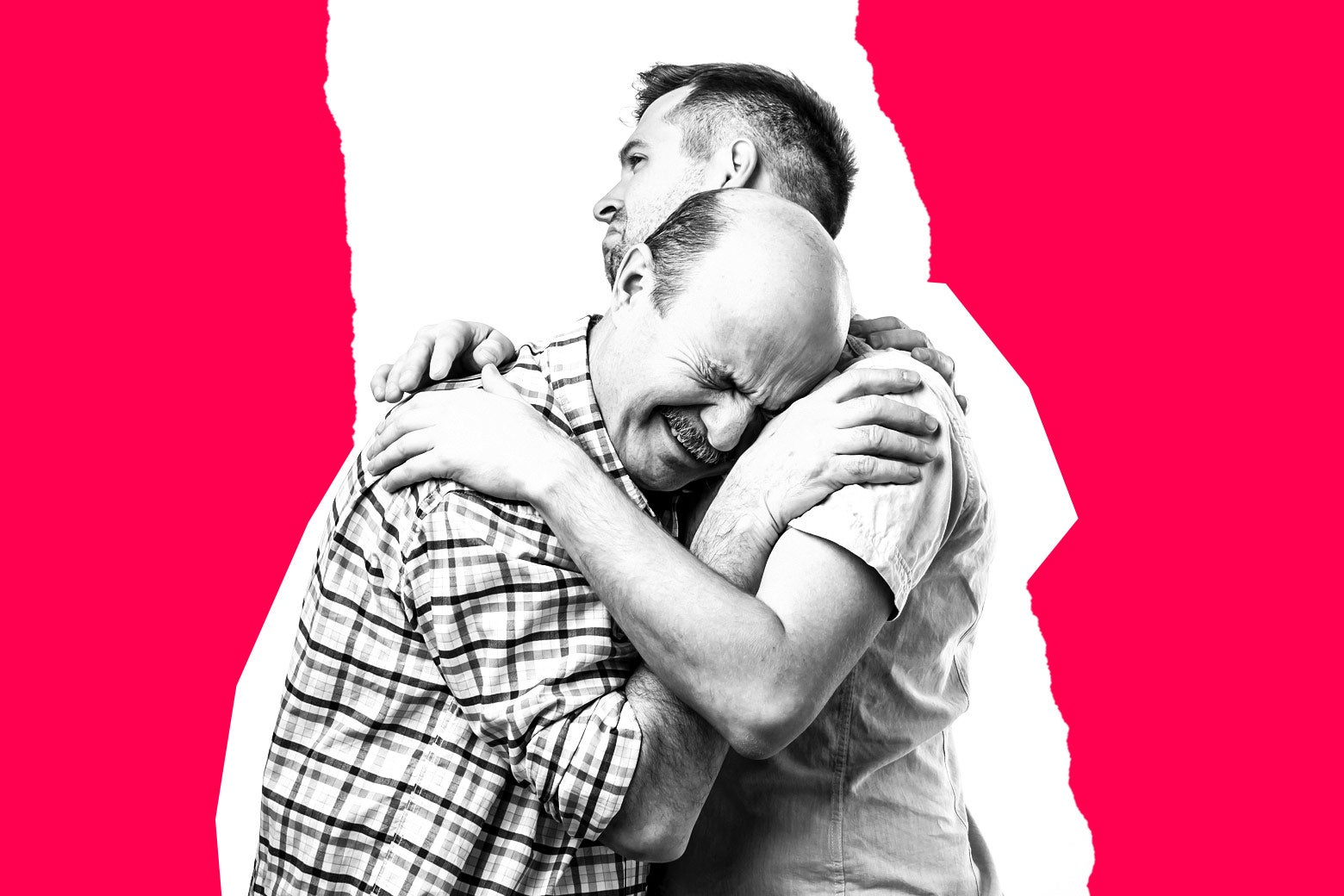 A man looks uncomfortable as his father embraces him.
