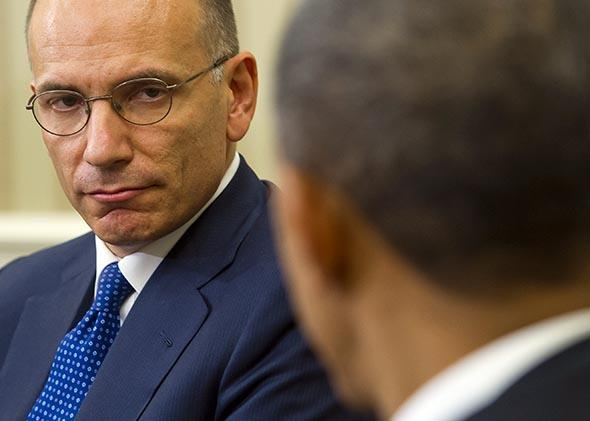 President Barack Obama and Italian Prime Minister Enrico Letta (L) hold a meeting in the Oval Office of the White House in Washington, DC, October 17, 2013.