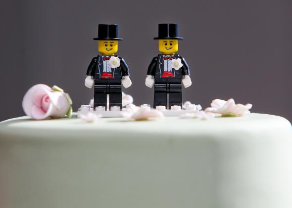 Two Lego men decorate the top of a wedding cake in Wellington, New Zealand. 176909561HH028_First_Austra