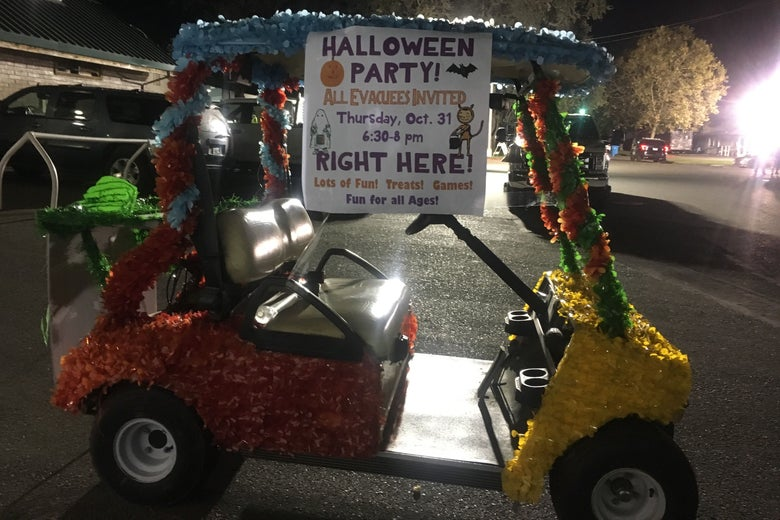 A golf cart greets evacuees at a Halloween party at a shelter at the Sonoma County Fairgrounds.