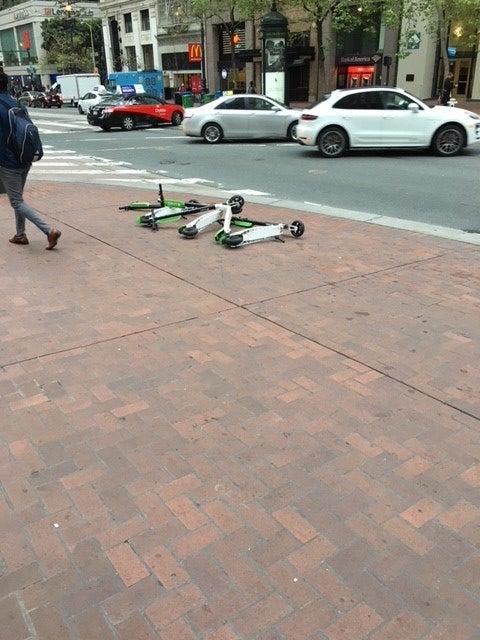 Scooters left on Market Street.