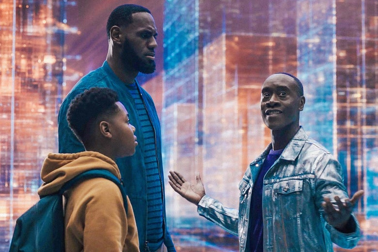 Don Cheadle shows the wonders of the Warner Bros. serververse to LeBron James and his son in a still from Space Jam: A New Legacy.