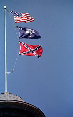 The Confederate flag atop the capitol building in South Carolina
