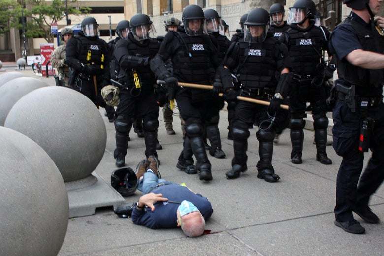 Martin Gugino, a 75-year-old protester, lays on the ground after he was shoved by two Buffalo, New York, police officers during a protest against the death in Minneapolis police custody of George Floyd in Niagara Square in Buffalo, New York, on June 4, 2020.