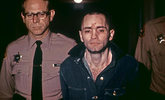 Beardless and shaven-headed, Charles Manson, goes to hear sentence of death passed by the court March 29, 1971, in Los Angeles.