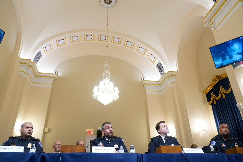 (L-R)US Capitol Police Sgt. Aquilino Gonell, Washington Metropolitan Police Department officer Michael Fanone, Washington Metropolitan Police Department officer Daniel Hodges and US Capitol Police Sgt. Harry Dunn watch as a video of rioters is played during the Select Committee investigation of the January 6, 2021, attack on the US Capitol, during their first hearing on Capitol Hill in Washington, DC, on July 27, 2021. - The committee is hearing testimony from members of the US Capitol Police and the Metropolitan Police Department who tried to protect the Capitol against insurrectionists on January 6, 2021. (Photo by Andrew Harnik / POOL / AFP) (Photo by ANDREW HARNIK/POOL/AFP via Getty Images)