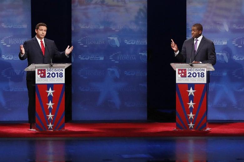 Republican Ron DeSantis (L) and Democrat Andrew Gillum debate at Broward College October 24, 2018 in Davie, Florida.