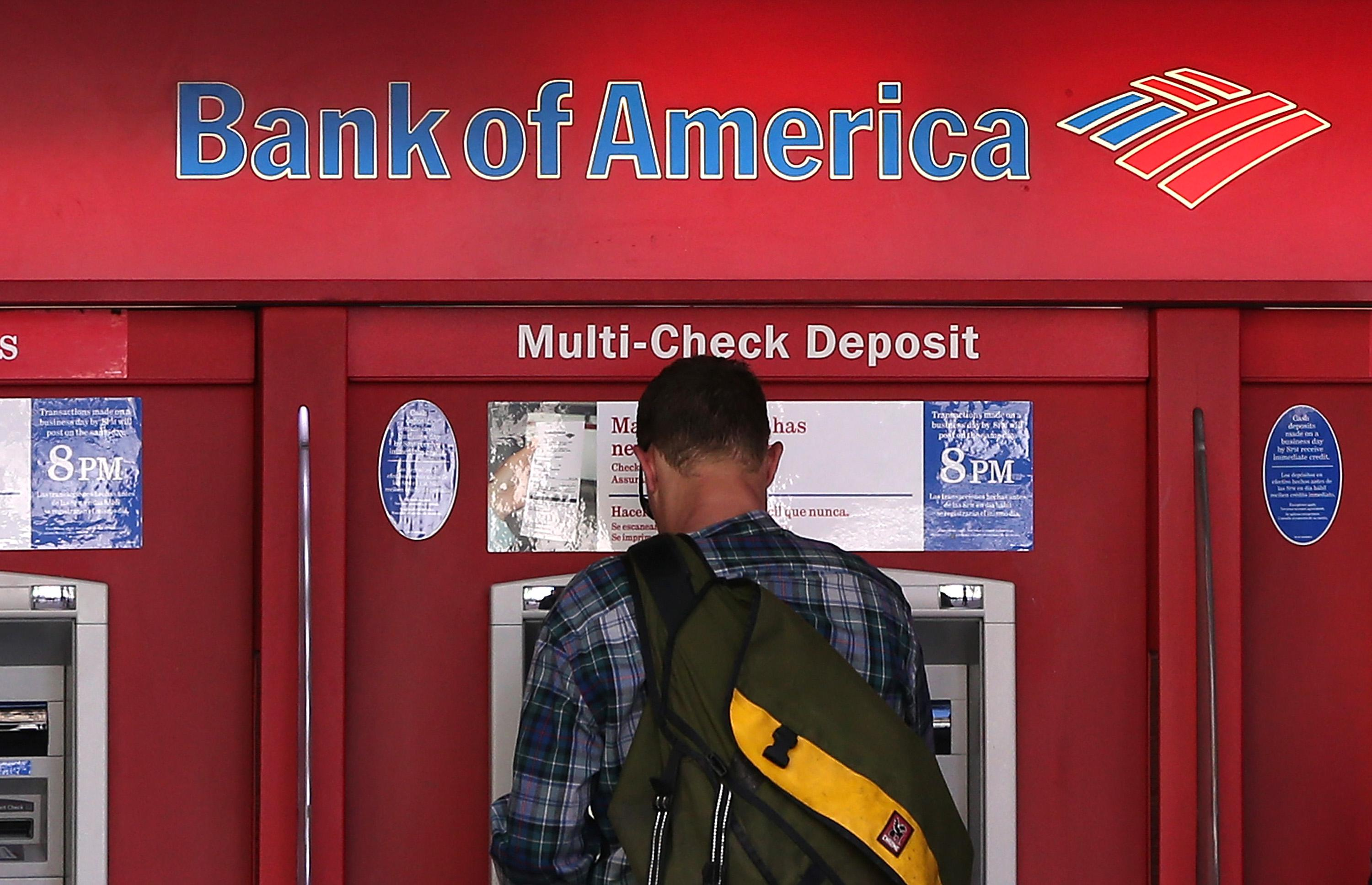 A man uses an ATM in San Francisco.