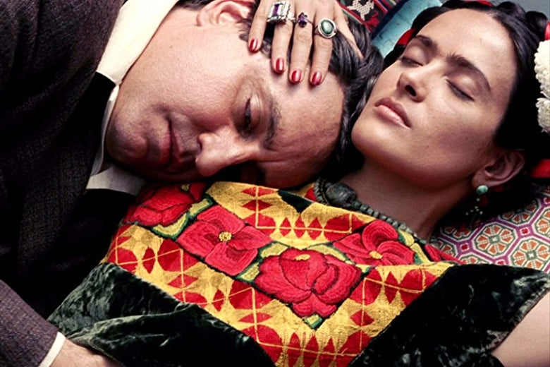 Salma Hayek and Alfred Molina lie down with their eyes closed.