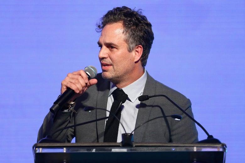 Mark Ruffalo speaking at a podium.