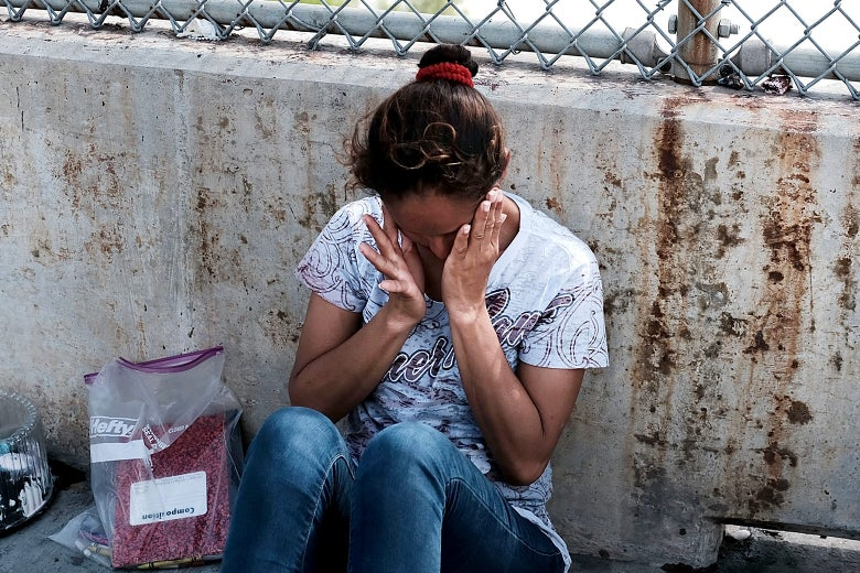 A Honduran woman, fleeing poverty and violence in her home country, waits along the border bridge after being denied entry into the U.S. from Mexico on June 25, 2018 in Brownsville, Texas.