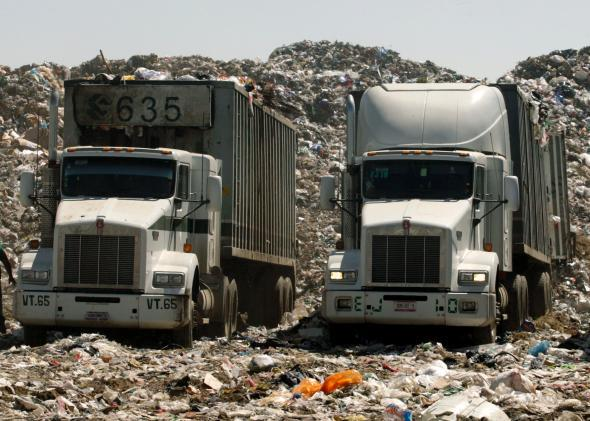 DATE IMPORTED: February 12, 2009 Trucks with garbage are parked at the Nezahualcoyotl dump site in Mexico City February 6, 2009.