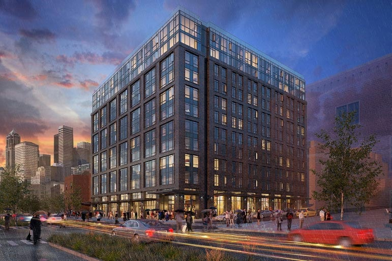 A rendering of a 12-story building rising above a busy city street.