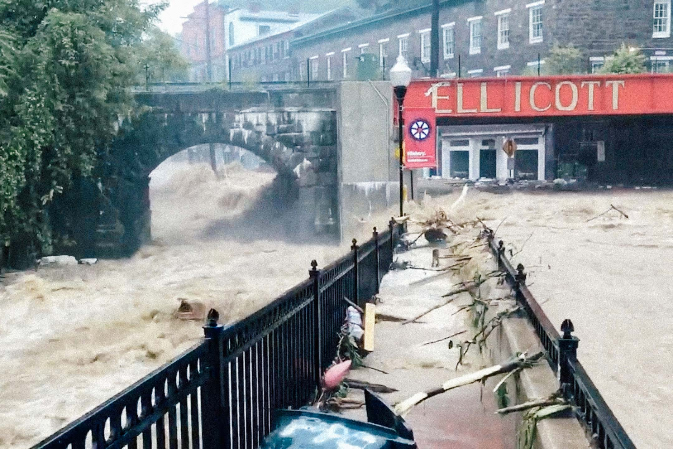 Flooding is seen in Ellicott City, Maryland, on Sunday in this still image from video from social media.