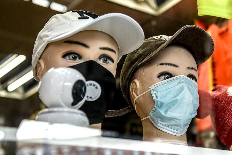 Masks on mannequins.