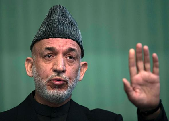 Afghan President Hamid Karzai addresses a press conference at the Presidential Palace in Kabul on January 25, 2014.