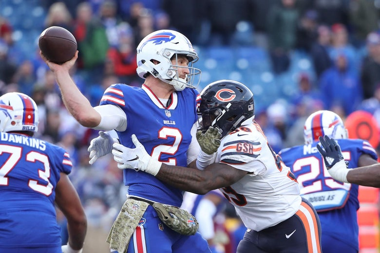 BUFFALO, NY - NOVEMBER 04: Nathan Peterman #2 of the Buffalo Bills is hit as he throws by Danny Trevathan #59 of the Chicago Bears in the fourth quarter during NFL game action at New Era Field on November 4, 2018 in Buffalo, New York. (Photo by Tom Szczerbowski/Getty Images)