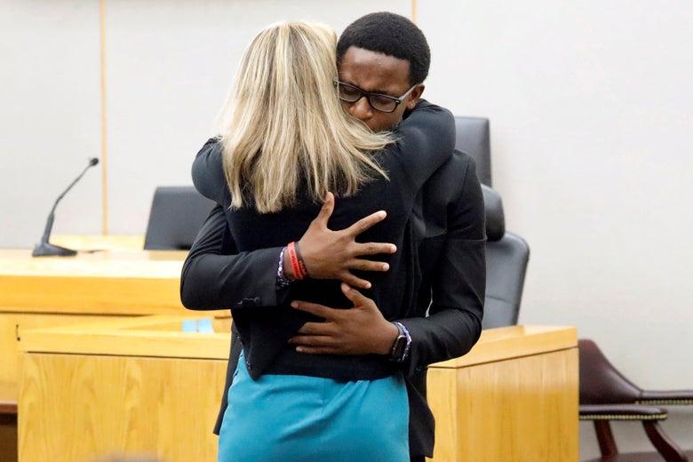 Brandt Jean embraces Amber Guyger.