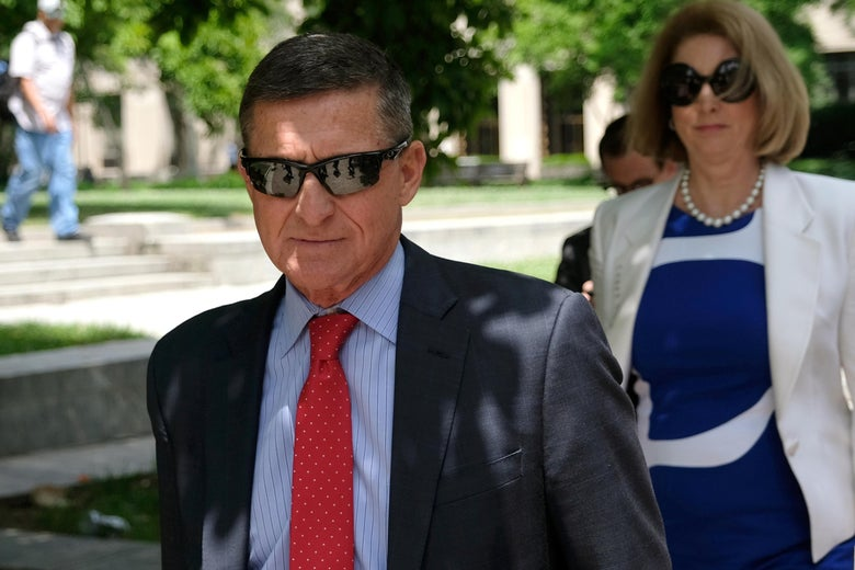 Flynn wearing sunglasses and a suit and tie outside