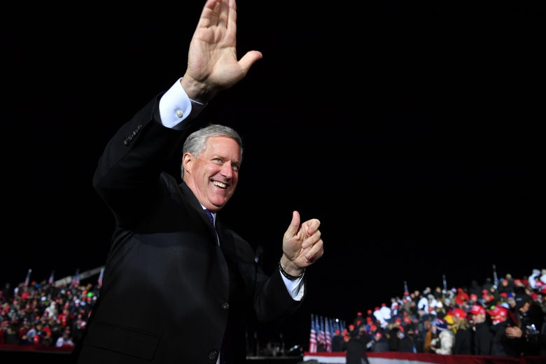 Then-White House Chief of Staff Mark Meadows waves as he arrives for a Donald Trump campaign rally at Waukesha County Airport in Waukesha, Wisconsin on October 24, 2020.