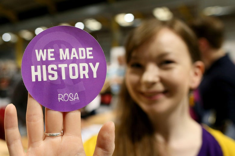 A Yes voter poses with a badge as votes are counted in the Irish abortion referendum, at the RDS Conference centre in Dublin on May 26, 2018.