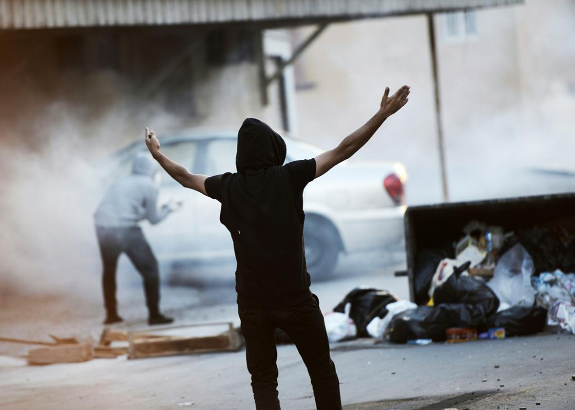 A Bahraini protester shouts slogans during clashes with riot police following a demonstration to mark the fifth anniversary of the Arab Spring-inspired uprising, on February 12, 2016, in the mainly Shiite village of Sitra, south of Manama.