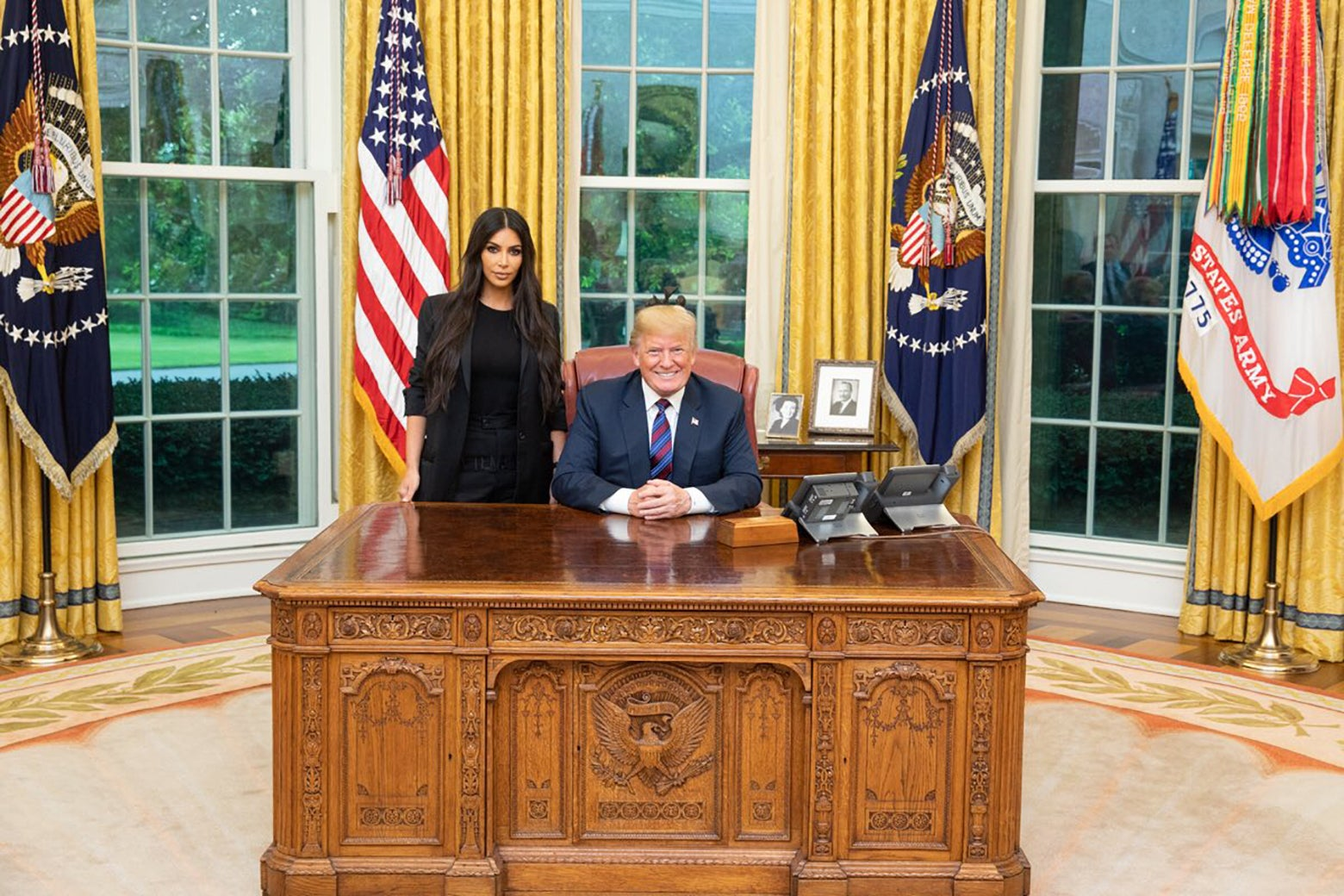 Kim Kardashian West and Donald Trump meet in the oval office.