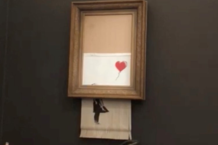 "Banksy's painting ""Girl with Red Balloon"" is seen shredded after its sale at Sotheby's auction in London on October 5, 2018 in this still image taken from a video obtained from social media on October 6, 2018."