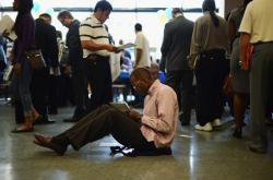 Job seekers at a job fair in Los Angeles, CA on May 31, 2012.