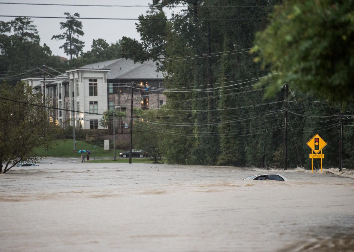 Flood waters engulf an abandoned vehicle on Forest Drive on Oct. 4, 2015, in Columbia, South Carolina.