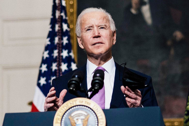 Biden gestures while speaking at a podium, with an American flag and a portrait of Abraham Lincoln in the background