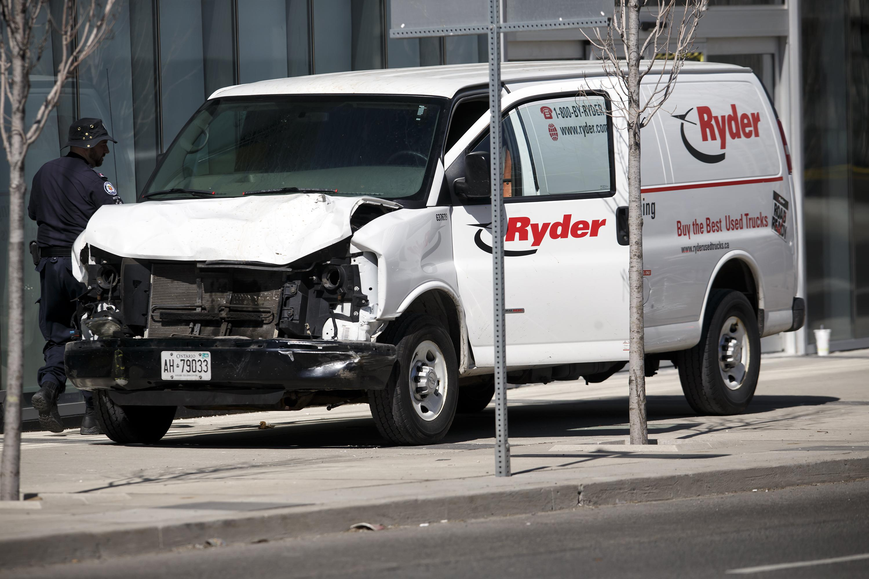 TORONTO, ON - APRIL 23:  Police inspect a van suspected of being involved in a collision injuring at least eight people at Yonge St. and Finch Ave. on April 23, 2018 in Toronto, Canada. A suspect is in custody after a white van collided with multiple pedestrians. (Photo by Cole Burston/Getty Images)