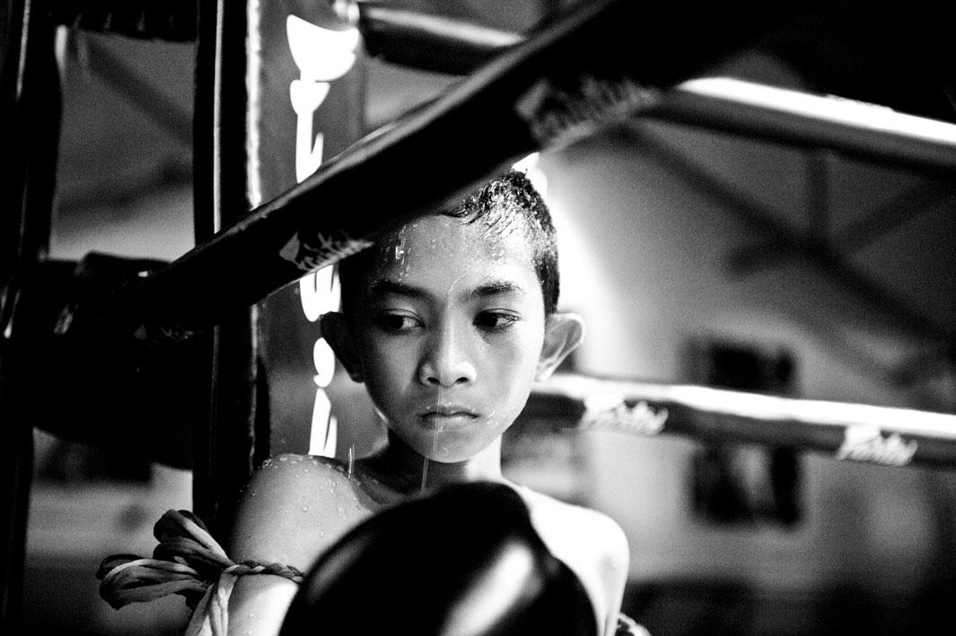 Boy in a boxing ring during the break.