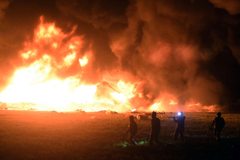 Flames burn at the scene of a massive blaze triggered by a leaky pipeline in Tlahuelilpan, Hidalgo state, on January 18, 2019. -