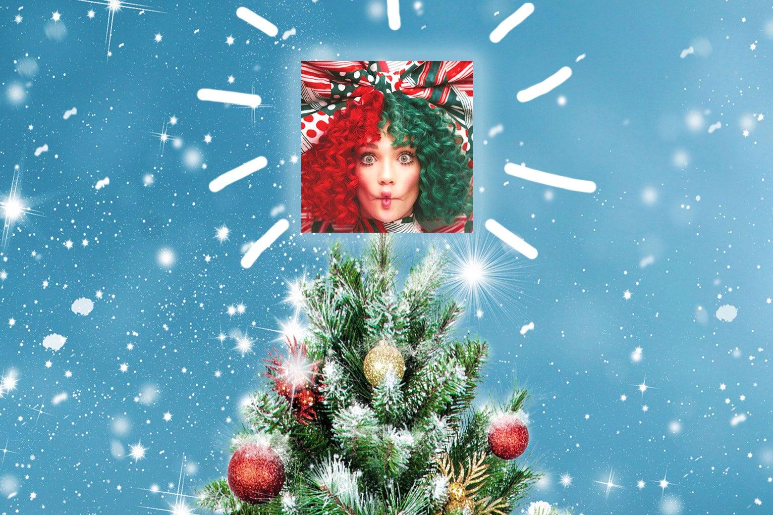 A Christmas tree w/ Sia's Christmas album on top.