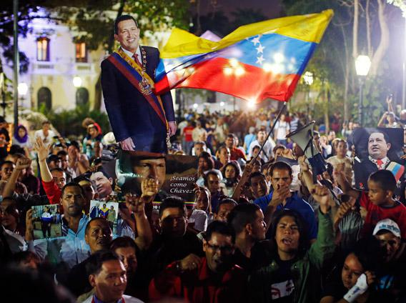Supporters of Venezuela's President Hugo Chavez react to the announcement of his death in Caracas, March 5, 2013.