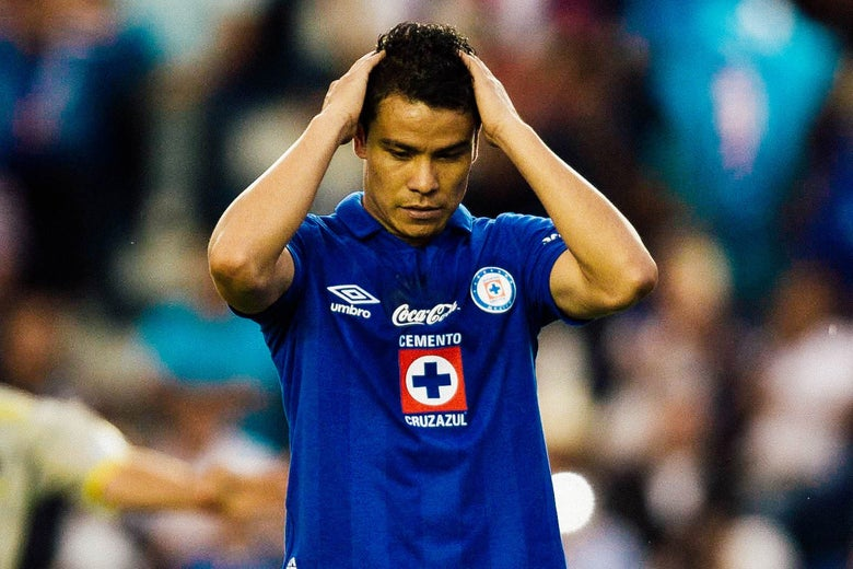 Pablo Barrera of Cruz Azul reacts after missing a penalty kick against Jaguares during their Mexican Apertura 2013 tournament football match in Mexico City, on July 30, 2013.