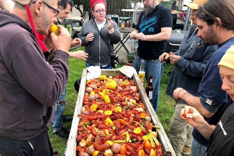A group of people enjoying a crawfish boil.