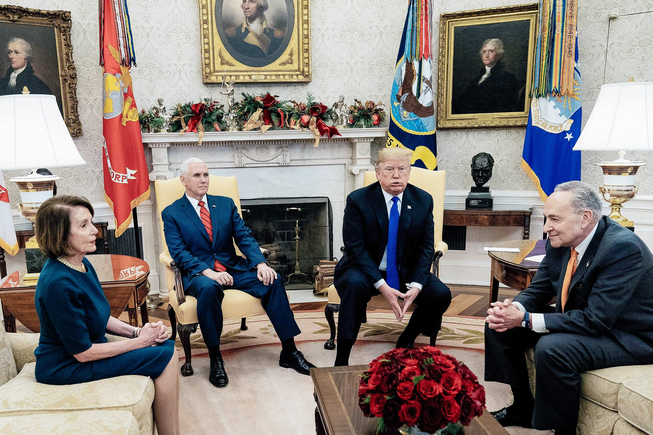 Nancy Pelosi, Mike Pence, Donald Trump, and Chuck Schumer sitting in the White House.