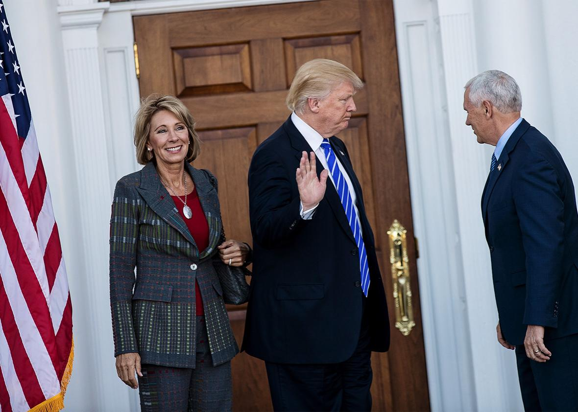 Betsy DeVos, president-elect Donald Trump and vice president-ele