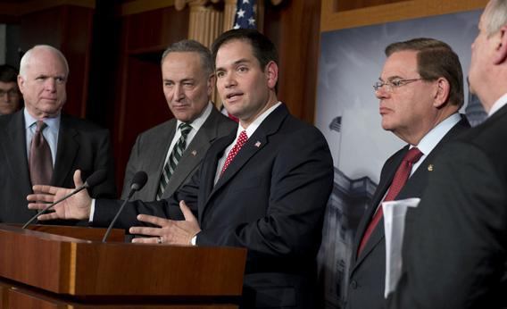 Senator Marco Rubio (C) speaks during a press conference on an agreement for comprehensive immigration reform.
