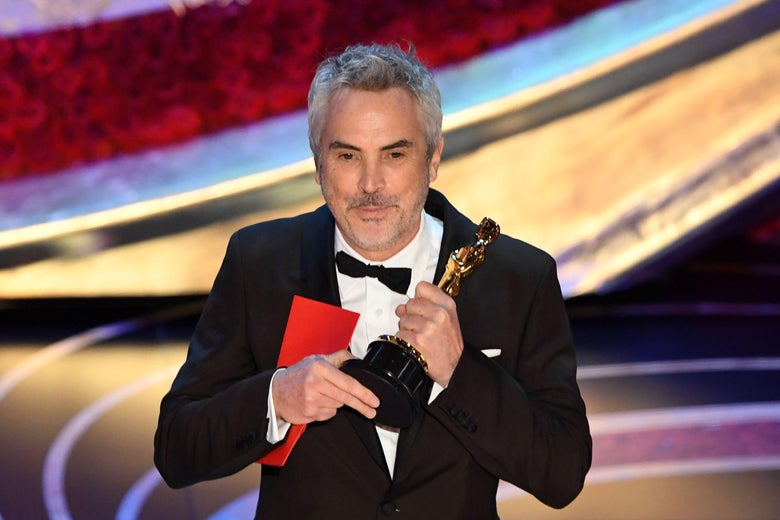 Best Foreign Language Film nominee for 'Roma' Mexican director Alfonso Cuaron accepts the award for Best Foreign Language Film during the 91st Annual Academy Awards at the Dolby Theatre in Hollywood, California on February 24, 2019. (Photo by VALERIE MACON / AFP)        (Photo credit should read VALERIE MACON/AFP/Getty Images)