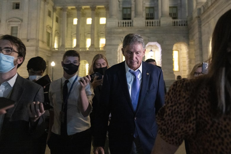 WASHINGTON, DC - SEPTEMBER 30: Sen. Joe Manchin (D-WV) exits the U.S. Capitol after meeting with White House officials September 30, 2021 in Washington, DC. Manchin has stated that he will not support a social policy spending package that goes over $1.5 trillion, at odds with the $3.5 trillion package supported by more liberal Democrats. (Photo by Drew Angerer/Getty Images)