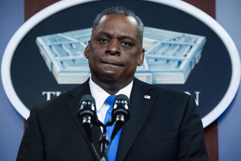 Lloyd Austin at a podium in front of the Pentagon logo.