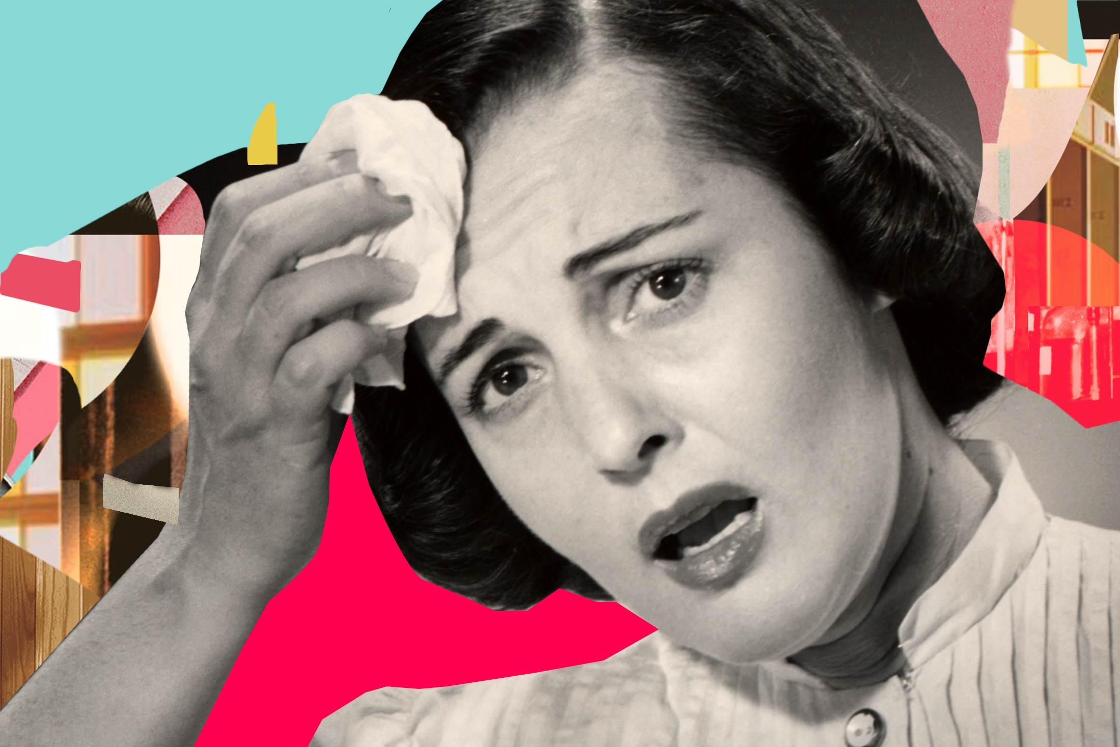 Worried woman wiping brow.