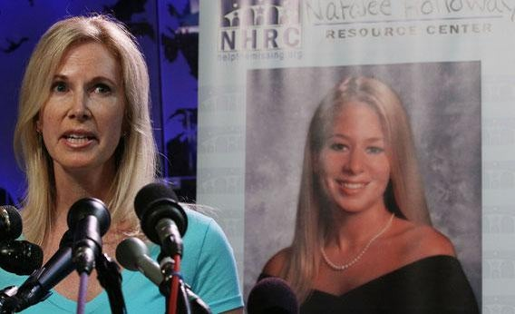 Beth Holloway with a photo of Natalee in the background