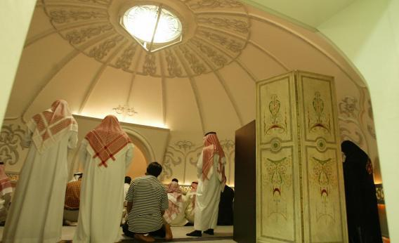 Saudi men perform their evening prayers inside a mosque.