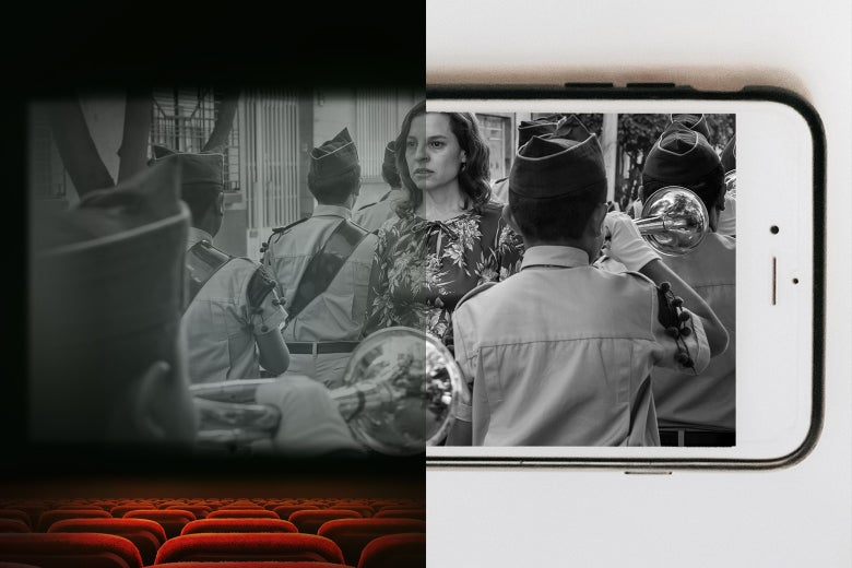 A scene from Roma seen on one side in a theater and on an iPhone on the other side.